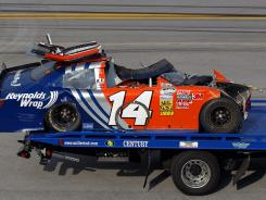 The Toyota of Eric McClure is hauled away after a vicious wreck Saturday at Talladega Superspeedway.
