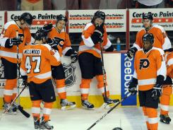 From left to right, James van Riemsdyk, Eric Wellwood, Eric Gutsafsson, Scott Hartnell, Wayne Simmonds and Matt Read watch the Devils celebrate after eliminating the Flyers in the Eastern Conference semifinals.
