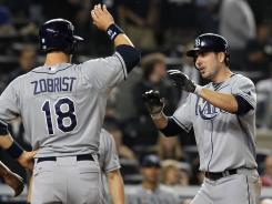 Ben Zobrist congratulates teammate Matt Joyce, right, after Joyce hit a three-run homer in the ninth inning to give the Rays the lead.