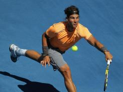 Rafael Nadal of Spain chases down a forehand during his victory Wednesday against Nikolay Davydenko of Russia.