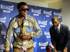 Los Angeles Clippers guard Nick Young, left, is styling much more than fellow guard Chris Paul, right, who initially had no words for his teammate's garb.