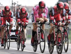 Taylor Phinney of the United States (third from right) pedals among his BMC teammates during the team time trial in the fourth stage of the Giro d'Italia in Verona, Italy, on Wednesday.