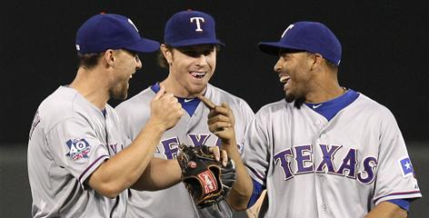 Josh Hamilton, center, shares a laugh with David Murphy, left, and Nelson Cruz after Hamilton sparked the Rangers over the Orioles Tuesday night. At 20-10 (.667), the Rangers have the best record in baseball.