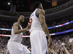 Philadelphia 76ers' Evan Turner, left, and Andre Iguodala react on the scorer's table after the 76ers won Game 6 and the first-round series over the Chicago Bulls on Thursday night at Philadelphia.