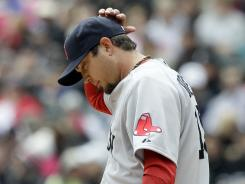 Josh Beckett is 2-3 with a 4.45 ERA for the last-place Red Sox.