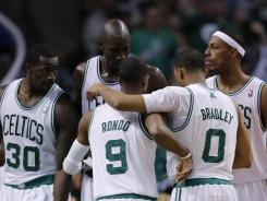 The Boston Celtics huddle during their Game 6 win over the Atlanta Hawks on Thursday at Boston. The Celtics advanced to the second round of the playoffs with the win.