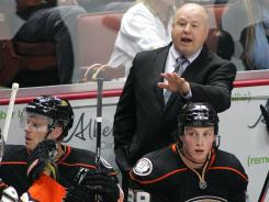 Bruce Boudreau, top right, earned 184 wins in his first 300 NHL games, the most by any coach in league history.
