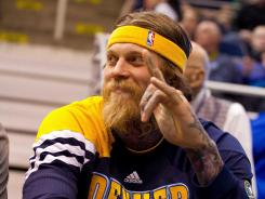 "Authorities say Chris ""Birdman"" Andersen has cooperated with their investigation of his home."