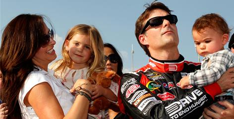 Jeff Gordon's family is shown at the Coca-Cola 600 on May 29, 2011. From left: Wife Ingrid Vandebosch; daughter Ella Sophia; Gordon, the four-time champion NASCAR driver; and son Leo Benjamin.