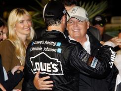 Jimmie Johnson celebrates with team owner Rick Hendrick after winning the Southern 500. Johnson's wife, Chandra, is at left.