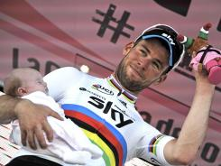 Britain's Mark Cavendish holds his daughter Delilah Grace on the podium after winning the fifth stage of the Giro d'Italia on Thursday.