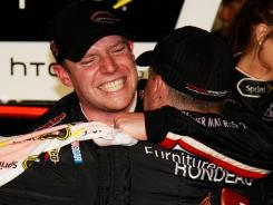 Regan Smith celebrates with his crew in victory lane after his shocking win in the 2011 Southern 500.
