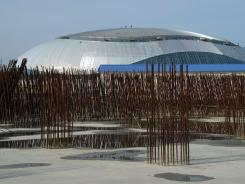 Engineers check the construction on the top of The Bolshoi Ice Dome in construction during a press trip to the Sochi 2014 Olympics venue in the Russian Black Sea resort of Sochi on Feb. 17, 2012. The Games will be the biggest international event hosted by Russia since the collapse of the Soviet Union.