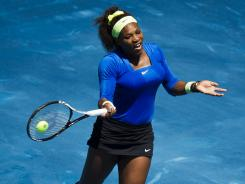 Serena Williams of the USA raps a forehand during her victory Thursday against Caroline Wozniacki of Denmark.