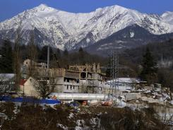 A photo taken on February 13, 2012 shows a building under contruction as part of preparations for the Sochi 2014 Winter Olympic Games near Krasnaya Polyana.