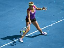 Victoria Azarenka from of Belarus lines up a forehand during her 3-6, 6-3, 6-3 victory Friday against Li Na of China.