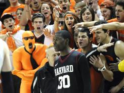 Princeton fans yell toward the direction of Harvard's Kyle Casey as he waits to inbound a pass during the one-game playoff to determine the 2011 Ivy League champion. That game was the closest the league has come to a real playoff.