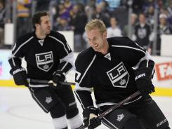 Mike Richards, left, and Jeff Carter were traded in separate deals 30 minutes apart last June by the Philadelphia Flyers.
