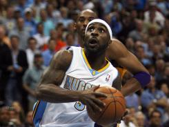 Denver Nuggets guard Ty Lawson (3) drives to the basket during the first half of Game 6 against the Los Angeles Lakers.