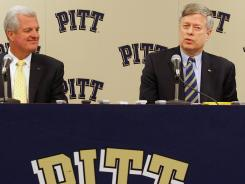 University of Pittsburgh athletic director Steve Pederson and Chancellor Mark Nordenberg speak during a press conference following the school's acceptance into the Atlantic Coast Conference on September 18, 2011.