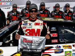 Greg Biffle celebrates winning the pole after Friday's qualifying for the Southern 500 at Darlington Raceway.