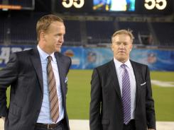 Peyton Manning (left) and John Elway attend the Celebration of Life for Junior Seau at Qualcomm Stadium on Friday.