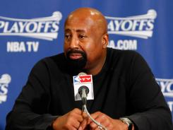 Interim New York Knicks coach Mike Woodson, to be considered for the fulltime job, was told to change to agents who have a better relationship with the organization than his current representation.