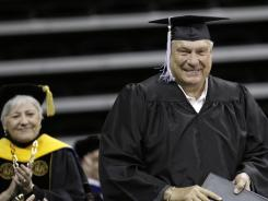 Former NBA player and coach Don Nelson receives his diploma during a commencement ceremony at the University of Iowa on Saturday. Nelson, a former Hawkeyes basketball player, NBA world champion and all-time winningest coach, left Iowa in 1962 just 10 credits short of getting his degree.