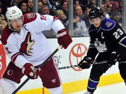 Kings captain Dustin Brown, right, defends against Coyotes captain Shane Doan during a Feb. 16 game.