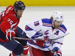 New York Rangers center Brad Richards, defended by Jason Chimera,