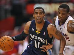 Los Angeles Clippers point guard Eric Bledsoe (12) defends Memphis Grizzlies point guard Mike Conley (11) in the first half of Game 6 on Friday at Los Angeles.