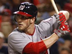 The Washington Nationals' Bryce Harper, waiting for a pitch Friday, was back in the lineup Saturday after he took an angry swing and his own bat accidentally hit him near the eye, causing blood to trickle down his face.