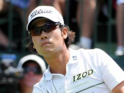 Kevin Na tees off on the first hole on his way to a third-round 68 and a one-shot lead at The Players Championship on Saturday.