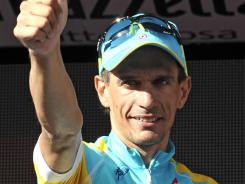 Paolo Tiralongo of Italy celebrates on the podium after winning the seventh stage of the Giro d'Italia from Recanati to Rocca di Cambio, Italy on Saturday.