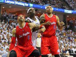 Clippers forwards Kenyon Martin (2) and Caron Butler (5) sandwich Memphis Grizzlies forward Zach Randolph, who was held to nine points on 3-of-12 shooting in the series-ending 82-72 loss Sunday to Los Angeles. Martin and Butler combined for 19 points and 15 rebounds.
