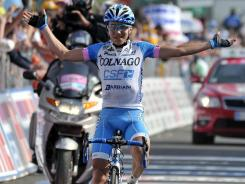 Domenico Pozzovivo celebrates as he crosses the finish line to win the eighth stage of the Giro d'Italia.