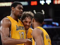 The Los Angeles Lakers' Andrew Bynum, Pau Gasol and Ramon Sessions talk in the first half while taking on the Denver Nuggets in Game 7 at Los Angeles.
