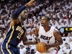 Miami Heat forward Chris Bosh, right, was hurt in the first half Sunday vs. the Indiana Pacers and left for the locker room.