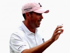 Matt Kuchar acknowledges the cheers after a birdie at No. 3 on his way to victory Sunday in The Players Championship.