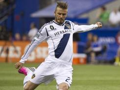 David Beckham of the Galaxy scores a goal against the Impact during the second half of their MLS match in Montreal.
