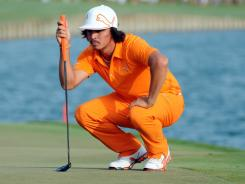 Rickie Fowler lines up his putt on the 18th during the TPC on Sunday.
