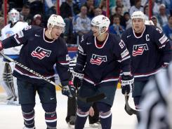 Max Pacioretty, center, celebrates his goal with U.S. teammate Paul Stastny, left, and Jack Johnson.