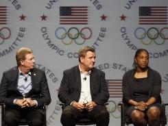 From left, U.S. Olympic Committee Chairman Larry Probst, CEO Scott Blackmun and 2012 U.S. Chef de Mission Teresa Edwards answer questions Sunday in Dallas.