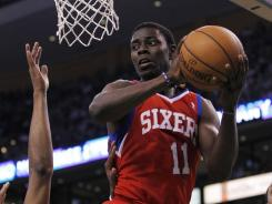 Philadelphia 76ers point guard Jrue Holiday (11) passes the ball against Boston Celtics small forward Paul Pierce (34) during the second quarter in Game 2.
