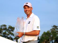 Matt Kuchar poses with his trophy after winning The Players Championship on Sunday.