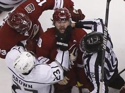 Los Angeles captain Dustin Brown grabs Phoenix counterpart Shane Doan in the third period.