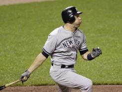 Mark Teixeira admires his two-run home run in the seventh inning, which gave his Yankees a 7-5 lead over the Orioles.