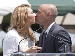 Andre Agassi kisses his wife Steffi Graf following his induction into the International Tennis Hall of Fame in July 2011 in Newport, R.I.