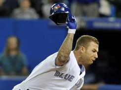 The Blue Jays' Brett Lawrie throws his batting helmet to protest a called third strike by plate umpire Bill Miller (not pictured) during Tuesday's game against the Rays.