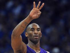 Lakers guard Kobe Bryant (24) signals a play to his team during the second quarter of Game 1 against the Thunder on Monday.